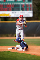 Ball State Cardinals second baseman Seth Freed (1) turns a double play as David Gulati (17) slides into second base during a game against the Villanova Wildcats on March 3, 2017 at North Charlotte Regional Park in Port Charlotte, Florida.  Ball State defeated Villanova 3-1.  (Mike Janes/Four Seam Images)