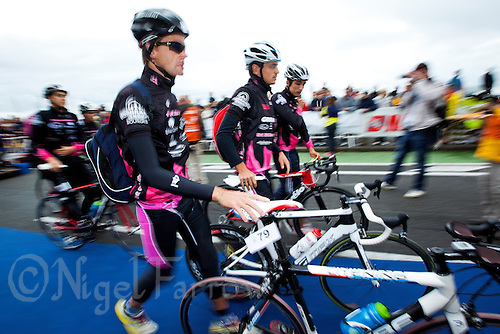 17 SEP 2011 - LA BAULE, FRA - Pierre le Noch (Tri St Amand Dun 18) enters transition with his team mates to rack their bikes ahead of the final round of the men's French Grand Prix Series at the Triathlon Audencia in La Baule, France (PHOTO (C) NIGEL FARROW)