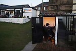 Bacup Borough 4 Holker Old Boys 1, 25/04/2016. Brain Boys West View Stadium, NorthWest Counties League Division One. The turnstile operator waiting for latecomers during the first-half at the Brain Boys West View Stadium as Bacup Borough (in black) play Holker Old Boys in a NorthWest Counties League division one fixture. Formed as Bacup in 1879, the club moved into their current home in 1889 and have been known as Bacup Borough since the 1920s, apart from a brief recent spell when they added the name Rossendale to their name. With both teams challenging for play-off places, Bacup Borough won this fixture by 4-1, watched by a crowd of 50. Photo by Colin McPherson.