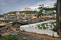 A cemetery in Elmina next to housing.