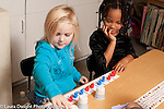 Education Elementary Kindergarten math activity on colors and patterns using partners creating patterns with small plastic colored bears and seeing if partner can guess pattern after lifting some of the paper cups hiding the bears