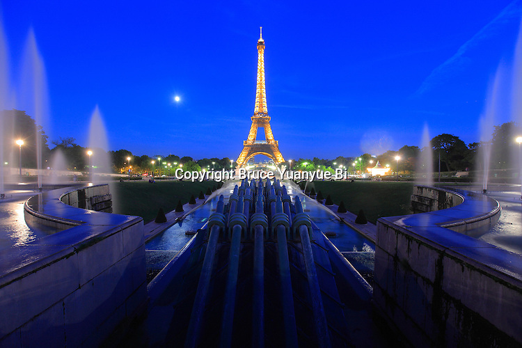 Twilight view of water cannon of the fountain in Jardins Trocadero with Eiffel Tower in the background.City of Paris. Paris. France