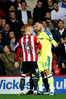 Richard Keogh of Derby County questions Ryan Woods of Brentford's involvement in the brawl during the Sky Bet Championship match between Brentford and Derby County at Griffin Park, London, England on 26 September 2017. Photo by Carlton Myrie / PRiME Media Images.