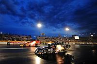 Nov. 1, 2008; Las Vegas, NV, USA: NHRA funny car driver John Force (near) races Cruz Pedregon during qualifying for the Las Vegas Nationals at The Strip in Las Vegas. Mandatory Credit: Mark J. Rebilas-