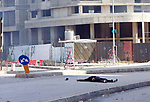 A person is seen on the ground after he was shot while preparing to fire a rocket-propelled grenade, amidst clashes in the area of Tayouneh, in the southern suburb of the capital Beirut, on October 14, 2021. - Gunfire killed several people and wounded 20 at a Beirut rally organised by the Shiite Hezbollah and Amal movements to demand the dismissal of the Beirut blast lead investigator, the state-run National News Agency said. Photo by Marwan Bou Haidar