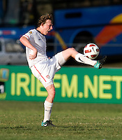 Matthew Dunn (5) of the USA takes a first touch on the ball during the group stage of the CONCACAF Men's Under 17 Championship at Jarrett Park in Montego Bay, Jamaica. The USA defeated Panama, 1-0.