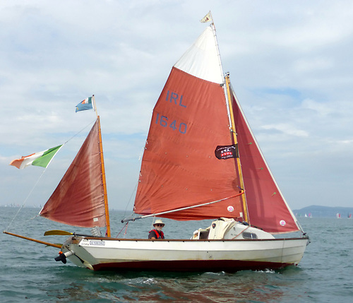 Jack O'Keeffe's Drascombe Coaster Tyboat sailing sweetly, with the mainsail's wishbone boom (one of Jack's many modifications) performing exactly as planned