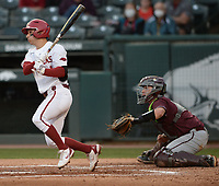 Arkansas second baseman Robert Moore hits a bases-loaded sacrifice fly Tuesday, April 6, 2021, scoring left fielder Zack Gregory during the second inning of play against UALR at Baum-Walker Stadium in Fayetteville. Visit nwaonline.com/210407Daily/ for today's photo gallery. <br /> (NWA Democrat-Gazette/Andy Shupe)