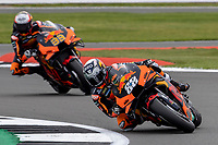 28th August 2021; Silverstone Circuit, Silverstone, Northamptonshire, England; MotoGP British Grand Prix, Qualifying Day; Team mates Red Bull KTM Factory Racing rider Miguel Oliveria on his KTM RC16 and Red Bull KTM Factory Racing rider Brad Binder on his KTM RC16