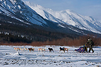 Chris Adkins (son of the first veterinarian on the Iditarod Terry Adkins) runs his team out of  the Rohn checkpoint at the confluence of the Tatina and the South Fork of the Kuskokwim Rivers during the 2010 Iditarod