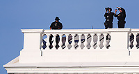 Secret Service agents on the roof as US President Donald J. Trump returns after posing with a bible outside St. John's Episcopal Church after delivering remarks in the Rose Garden at the White House in Washington, DC, USA, 01 June 2020. Trump addressed the nationwide protests following the death of George Floyd in police custody.<br /> Credit: Shawn Thew / Pool via CNP/AdMedia