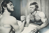 1974 FILE PHOTO -<br /> <br /> Muscles bulge as Bobby Hull (right) arm wrestles with Gilles Gratton; a backup Goalie with team Canada. Hull is expected to be key performer in the Team Canada-Soviets hockey series which opens Tuesday night in Quebec city<br /> <br /> 1974<br /> <br /> PHOTO : Graham Bezant - Toronto Star Archives - AQP