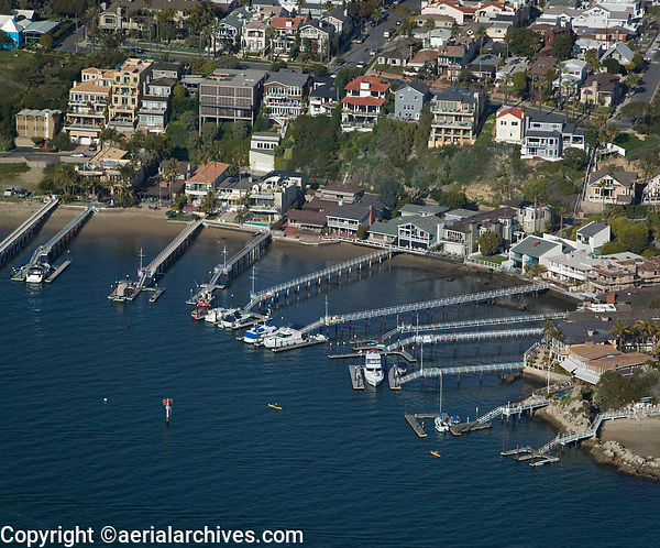 aerial photograph of waterfront homes and piers, Orange County, California