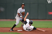 Clinton Lumberkings Jose Vallejo attempts to turn a double play as Craig Tatum slides in during a Midwest League game at Fifth Third Field on July 18, 2006 in Dayton, Ohio.  (Mike Janes/Four Seam Images)