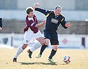 Arbroath's Steven Doris and Albion's Peter Innes challenge for the ball.