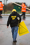 © Joel Goodman - 07973 332324 . 26/01/2014 . Salford , UK . A woman wearing a Frack Off hoody . Approximately 500 protesters march to an iGas fracking exploration site at Barton Moss , Salford , today (Sunday 26th January 2014) . They walk along the A57 road , blocking traffic as they do . A long term protest camp has been established on an access road leading to the site and today (26th January) protesters from other areas of the country travelled to the site to join with other protesters against fracking . Photo credit : Joel Goodman