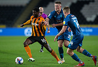 Hull City's Hakeeb Adelakun battles with Grimsby Town's Mattie Pollock and Luke Spokes<br /> <br /> Photographer Alex Dodd/CameraSport<br /> <br /> EFL Papa John's Trophy - Northern Section - Group H - Hull City v Grimsby Town - Tuesday 17th November 2020 - KCOM Stadium - Kingston upon Hull<br />  <br /> World Copyright © 2020 CameraSport. All rights reserved. 43 Linden Ave. Countesthorpe. Leicester. England. LE8 5PG - Tel: +44 (0) 116 277 4147 - admin@camerasport.com - www.camerasport.com