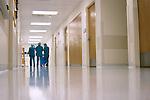 Nurses walk down hallway after surgeries are done..