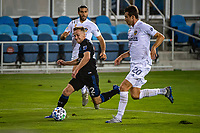 SAN JOSE, CA - SEPTEMBER 13: Tommy Thompson #22 of the San Jose Earthquakes passes Nick DePuy #20 of the LA Galaxy during a game between Los Angeles Galaxy and San Jose Earthquakes at Earthquakes Stadium on September 13, 2020 in San Jose, California.