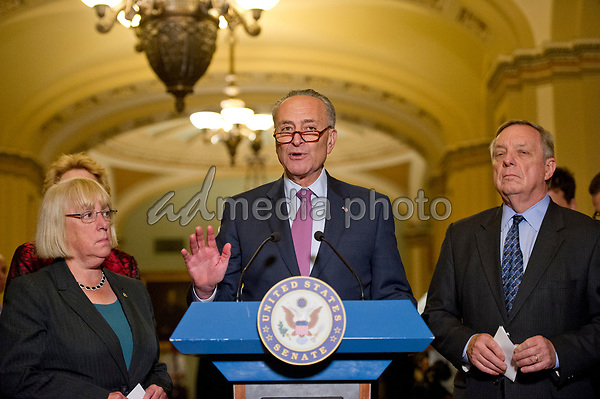 United States Senate Minority Leader Chuck Schumer (Democrat of New York) speaks to reporters following the Democratic Party luncheon in the United States Capitol in Washington, DC on Tuesday, June 27, 2017.  From left to right: US Senator  (Democrat of Illinois). Photo Credit: Ron Sachs/CNP/AdMedia