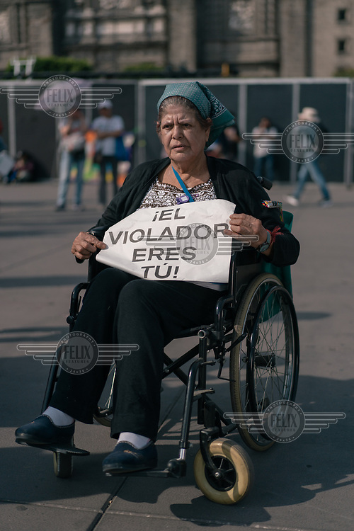 Maria Marquez (60) in the Zocalo Plaza during a protest on International Women's Day. ''For me, being a woman is the best, a woman is worth gold.'' ''I came to the march to fight for my people.''