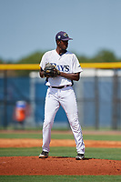 GCL Rays relief pitcher Jhoanbert Cedeno (20) gets ready to deliver a pitch during a game against the GCL Twins on August 9, 2018 at Charlotte Sports Park in Port Charlotte, Florida.  GCL Twins defeated GCL Rays 5-2.  (Mike Janes/Four Seam Images)