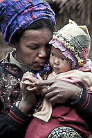 A Kachin refugee mother embraces her baby at the Je Gau Pa IDP camp, located at the high mountains of northeastern Kachin State. This camp is one of the most remote temporary shelters settled under tough and poor conditions. The camp gives shelter to two thousand displaced persons from the war-torn villages close to Maiya Jang city.