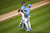 North Carolina Tar Heels catcher Tomas Frick (52) jumps into the arms of relief pitcher Caden O'Brien (34) after the final out in the game against the South Carolina Gamecocks at Truist Field on April 6, 2021 in Charlotte, North Carolina. (Brian Westerholt/Four Seam Images)