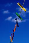 Multi colored clothespins on clothesline in backyard on a sunny blue sky day Marysville Washington State USA