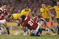 MELBOURNE, 29 JUNE 2013 - Michael HOOPER of the Wallabies is tackled by Conor MURRAY of the Lions during the Second Test match between the Australian Wallabies and the British & Irish Lions at Etihad Stadium on 29 June 2013 in Melbourne, Australia. (Photo Sydney Low / sydlow.com)