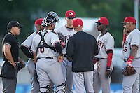 Hickory Crawdads pitching coach Oscar Marin (center) has a meeting with starting pitcher Brett Martin (10) during the game against the Kannapolis Intimidators at CMC-Northeast Stadium on May 22, 2015 in Kannapolis, North Carolina.  The Intimidators defeated the Crawdads 4-3.  (Brian Westerholt/Four Seam Images)