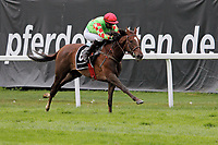 15th May 2020, Muenchen-Riem racecourse, Munich, Germany. Flat racing;  Pietra della Luna with Sibylle Vogt up arrives at the finish line as he races away