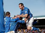 Frazer Wright leaps on top of goalscorer Steven Anderson