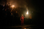 A family lights sparklers and other fireworks in the crowd gathered in Stalin Park on the banks of the Songhua River during Lantern Festival celebrations in central Haerbin, Heilongjiang Province, China.