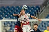 FOXBOROUGH, MA - AUGUST 21: Nicolas Firmino #29 of New England Revolution II and Luke Pavone #14 of Richmond Kickers battle for head ball during a game between Richmond Kickers and New England Revolution II at Gillette Stadium on August 21, 2020 in Foxborough, Massachusetts.