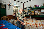 Father Laborde at his room in the boys hostel of Ekpranta Nagar school where he stays during his visit to the school. West Bengal, India, Arindam Mukherjee/Agency Genesis