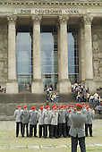 A German military unit poses for a photograph in front of the Reichstag, which houses the German Parliament in Berlin.