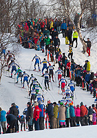Men's 30k Classic racers make their way up Gong Hill during the 2018 U.S. National Cross Country Ski Championships at Kincaid Park in Anchorage.
