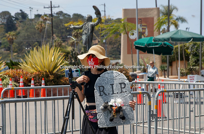 DEL MAR, CA  JULY 16: Animal Extremist holding headstone with a cow on it outside the racetrack. (Photo by Casey Phillips/ Eclipse Sportswire/CSM)