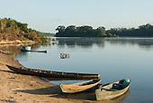 Pará State, Brazil. Iriri River. Aldeia Kararaô (Kayapó). Riverside, plank canoes.