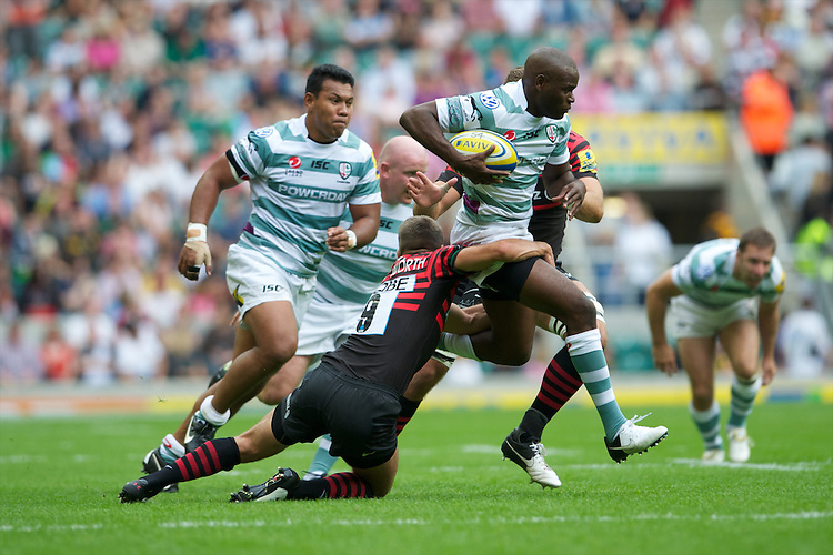 Topsy Ojo of London Irish is tackled by Richard Wigglesworth of Saracens during the Aviva Premiership match between Saracens and London Irish at Twickenham on Saturday 1st September 2012 (Photo by Rob Munro)