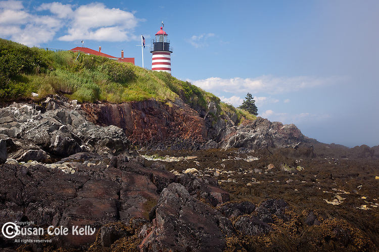 West Quoddy Head Light guards the rocky coast of Maine at Quoddy Head State Park, Lubec, ME, USA