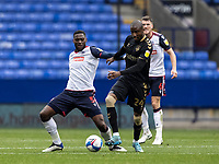 Bolton Wanderers' Ricardo Santos (left) competing with Oldham Athletic's Dylan Bahamboula<br /> <br /> Photographer Andrew Kearns/CameraSport<br /> <br /> The EFL Sky Bet League Two - Bolton Wanderers v Oldham Athletic - Saturday 17th October 2020 - University of Bolton Stadium - Bolton<br /> <br /> World Copyright © 2020 CameraSport. All rights reserved. 43 Linden Ave. Countesthorpe. Leicester. England. LE8 5PG - Tel: +44 (0) 116 277 4147 - admin@camerasport.com - www.camerasport.com