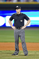 Umpire Ben Levin handles the calls on the bases during the Carolina League game between the Wilmington Blue Rocks and the Winston-Salem Dash at BB&T Ballpark on April 3, 2014 in Winston-Salem, North Carolina.  The Blue Rocks defeated the Dash 3-1.  (Brian Westerholt/Four Seam Images)