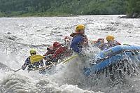 Tourists enjoy paddle rafting down the Nenana river, Denali Park, Alaska