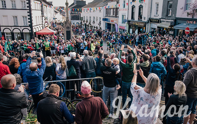 Riders cheered on while racing through a crowded town in/around Lake District National Parc / Cumbria<br /> <br /> Stage 6: Barrow-in-Furness to Whinlatter Pass   (168km)<br /> 15th Ovo Energy Tour of Britain 2018