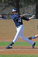 John Long #18 of East Tennessee State University follows through on his swing at Greenwood Field against the the University of North Carolina Asheville on March 2, 2011 in Asheville, North Carolina.  East Tennessee State University won 13-5.  Photo by Tony Farlow / Four Seam Images..