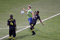 COLUMBUS, OH - DECEMBER 12: Raul Ruidiaz #9 of the Seattle Sounders FC is defended by Harrison Afful #25 of the Columbus Crew during a game between Seattle Sounders FC and Columbus Crew at MAPFRE Stadium on December 12, 2020 in Columbus, Ohio.