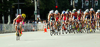 29 JUN 2014 - CHICAGO, USA - Fernando Alarza (ESP) (left) of Spain checks for anybody following him on a break on the bike during the elite men's ITU 2014 World Triathlon Series round in Grant Park, Chicago in the USA (PHOTO COPYRIGHT © 2014 NIGEL FARROW, ALL RIGHTS RESERVED)
