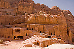 """Street of Facades,"" Petra, Jordan.  Layer upon layer of Nabatean tombs carved by hand from the rock wall of the valley, at the so-called ""Street of Facades"" or necropolis near the entrance to Petra.  © Rick Collier"